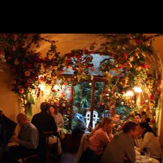 Interior view of one of cafe schober's eating areas. Schober is a fairy tale like cafe. Decorated with rediculously large amounts of flowers and twinkle lights and amazing pastries!!!