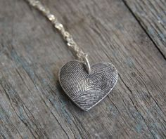 Custom Heart Fingerprint Necklace by FlirtandFlutter --- love this idea, I would make something similar out of polymer clay.