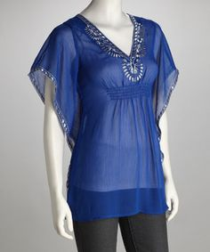 This chic cobalt blue tunic's trendy cape sleeves add sweet sophistication to the sultry silhouette. This sheer piece can be sported as a swimsuit cover-up or rocked over a camisole as a top.
