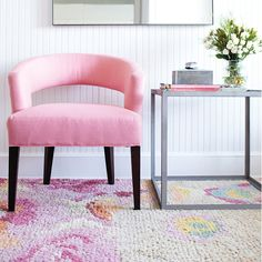 Light, fresh, and feminine, this look is all about simple, streamlined silhouettes and a pretty pastel palette. A large-scale floral rug in textured, woven wool provides a bold visual and harmonizes with the romance of the coral linen chair. Pair it with the simplicity of a clean-lined metal table and unadorned mirror to create a contemporary and welcoming look.