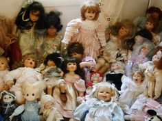 Hundreds of collectible dolls, porcelain, cloth, character, some in original boxes, doll stands are included.