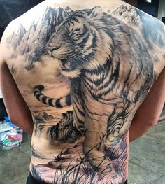 45 Awesome Back Tattoos For Men Tiger Tattoo Back, Mens Tiger Tattoo, Tiger Tattoo Design, Lion Tattoo, Back Tattoos For Guys, Full Back Tattoos, Body Art Tattoos, Sleeve Tattoos, Japanese Tatoo