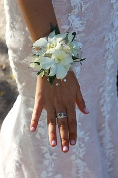 Prom corsage; wristlet; white dendrobium orchid; with rhinestone bling Lisa Foster Floral Design www.lisafosterdesign.com