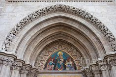 19th century bas-relief of the Madonna with Child between two angels on the Matthias Church tympanum in Budapest, Hungary.