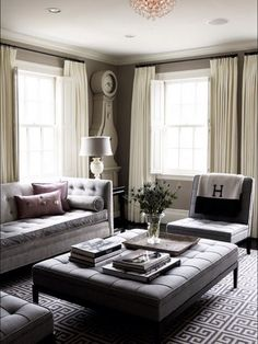 Simple Gray Tufted Furniture, Dark Walls, and an Hermes Blanket. What's not to Love.