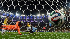 Uruguay's goalkeeper Fernando Muslera fails to save Colombia's midfielder James Rodriguez' second goal during the Round of 16 football match between Colombia and Uruguay at the Maracana Stadium in Rio de Janeiro during the 2014 FIFA World Cup in Brazil on June 28, 2014. AFP PHOTO / LUIS ACOSTA