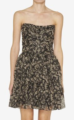 I'd  def wear this I'm loving anything sleeveless, strapless this summer.Dolce & Gabbana Nude And Black Dress | VAUNTE
