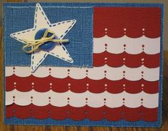 handmade Fourth of July card ... evokes the flag ... red, white and blue ... one sweet star with faux stitching and a button center ... stripes of punched edges in red and white ... like this card!!