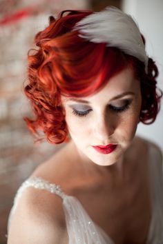 Pin curls, red lips, & an amazing feather fascinator. Our vintage bride rules!