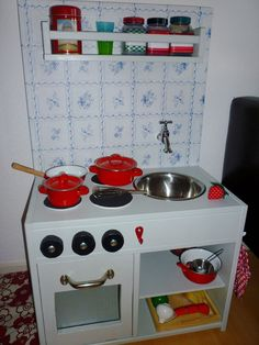 another use for those IKEA spice racks! Love these DIY kids kitchens.