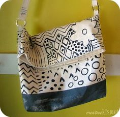 love the closure of this bag... how it just folds over instead of a zipper or snap or whatever