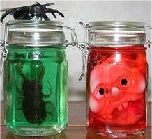 Scary Halloween Jars, the Dollar Store has these jars, water & food coloring and add scary creatures :)