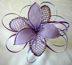 Needle lace by Maureen Bromley.  Very sweet!  Re-ignites my interest in needle lace.