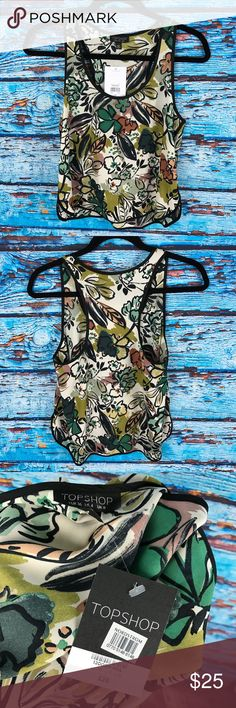 Top Shop Sz 4 Floral 🌸 Racer Back Tank Top NWT Topshop Sz US 4 UK 8 EUR 36  Floral Racerback Blouse Sleeveless Tank Top  See photos for exact details Size US 4 Armpit to armpit: 17 inches Total length from top of shoulder to bottom hem: 22 inches Topshop Tops Tank Tops