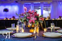 Wedding Reception | Purple Lighting | Gold Chargers | Gold Vases | Pink Lily | Lavender Rose | Purple Tulip | Photo Credit - Claire Ryser Photography