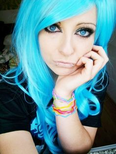 I would never personally do this, but I love that her eyes match her hair..pretty!