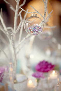 Buy cheap clear baubles and fill with instrument of choice. Would look beautiful with beads, buttons, glitter, confetti, hearts and so much more!