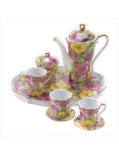 Some faries like tea from a Rose Minature English Tea Set!!!