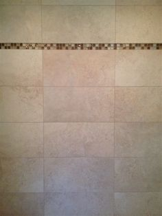 Tampa, Florida tile shower installation project. (12x24 rectified porcelain tile w/ mixed glass mosaic accent band) #tile #tampa #shower #niche #ceramictec
