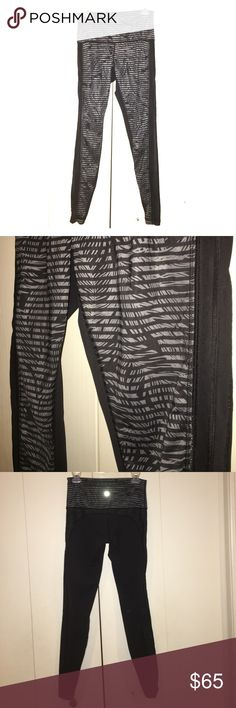 Lululemon feather striped mesh leggings size 8 EUC Rare! lululemon high waisted black and gray striped leggings in luxtreme fabric with sexy sheer mesh side detail.  No pilling or signs of wear at all! Coming from a smoke free home. Size 8  Happy Poshing! 🛍💕 lululemon athletica Pants Leggings