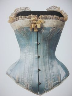 "Corset 1870s-1880s    Dimension: 76 cm (bust) / 49 cm (waist)    This corset is a vivid reminder of the painting, ""Nana,"" by Edouard Manet (1832–1883). The center-front busk and bones mold the curve from the waist to the abdomen, while neatly arranging the lower abdomen, as well. Women used corsets in an effort to get closer to an ideal physical form of the time; until the beginning of the 20th century, their waists were tightened by the corset. With the development of modern technology, people applied their creative originality and corsets by new devices were born. In particular, the invention of eyelet in 1828 allowed great improvements in the tightening of the waist on a corset.    The Kyoto Costume Institute"