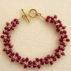 stunning garnet colour firepolish crystal daisy flower bracelet - can figure out the pattern