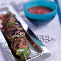 Grilled Lamb Kebabs with Smoky Tomato Sauce | This simple lamb kebab is inspired by a great summer recipe from Turkey in which lean lamb is marinated with garlic and pepper, grilled, then cubed and simmered with wood-fired tomatoes. Musa Dagdeviren, recognizes the perfection of this recipe, which is why he adds no extra spices or other flavorings.