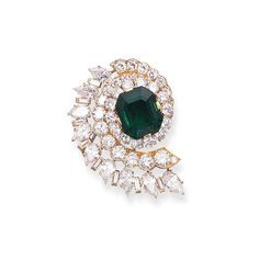 AN ATTRACTIVE EMERALD AND DIAMOND CLIP BROOCH, BY VAN CLEEF & ARPELS  Set with a cut-cornered rectangular-cut emerald weighing 10.43 carats within a vari-cut diamond swirl surround, mounted in 18k gold, 1952