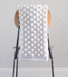 This is a free pattern for a crochet polka dot blanket. The idea all started for this crochet polka dot blanket when I learned how to do the bobble stitch. If you don't know how to work one, I have a clip you can watch below. (A bobble stitch is simply 5 DCTOG.)