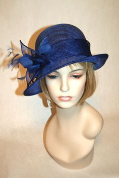 Very chic blue sinamay cloche hat! A great Kentucky Derby Hat for a cloche smaller brim fan. Click on the photo to purchase $99
