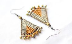 Brown macrame earrings, african brown earrings, tribal brown earrings, tribal jewelry, alternative brown earrings, rustic brown earrings.  This earrings are made by beige, orange and brown polyester waxed yarn and antique bronze beadings. Toppers included. You can choose an antique gold or silver tone finish for the beadings and earwire, and the thread colors on the last picture.  Add sterling silver earwires…