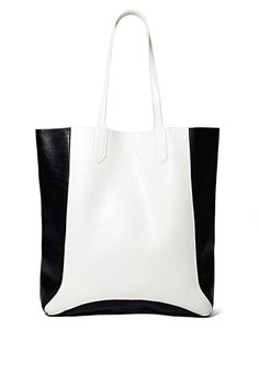 NASTY GAL BACK TO THE BASICS TOTE $45 Crisp and simple, this look is perfect for pairing with your more tailored outfits this season.
