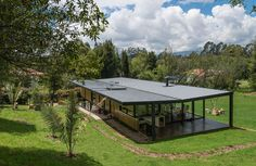 Modern home located in La Sabana , near the city of Bogotá in Colombia. Container House Design, Small House Design, Modern House Design, Beach House Plans, Cottage House Plans, Prefabricated Houses, Prefab Homes, Flooded House, House Cladding