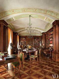 Studio Peregalli designed an apartment in Naples, Italy, featuring an ornate library with a vaulted ceiling and a diamond-pattern floor composed of walnut, cherry, and maple.