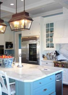 Love the countertops and cabinets... also love the touches of blue