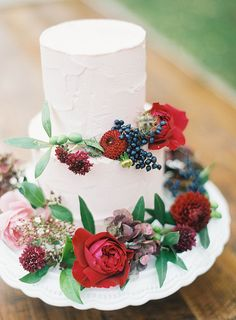 #wedding cake with bold colored florals