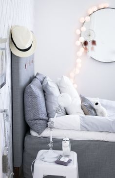 Lovely Fairy Lights across a Mirror in a Bedroom.