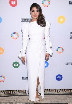 Vision in white: Priyanka Chopra, 35, turned heads in a glamorous white long-sleeved gown ...