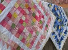 A Hundred Hugs Baby Quilt - Make a beautiful baby quilt pattern with nine patch quilt blocks and a colorful charm pack pattern or jelly roll quilt pattern. It's perfect for both boys and girls.