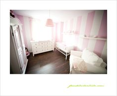 pink and white baby room