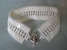 PRICE REDUCED 30  Ivory Bugle Beaded Woven Bracelet by elsielight  on etsy.