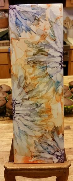 Playing with lighter colors. Flower in alcohol ink on 12x4 tile by Tina