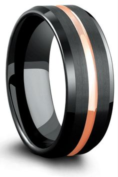Black tungsten wedding ring with matte textured finish and an 18k rose gold center channel. I love the design of this mens wedding ring. It adds both the modern wedding ring and the classic! LOVE IT.