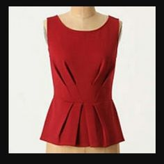 Anthropologie peplum top NWT Bailey 44 Slimming and stylish peplum top brand new with overstock tag from Anthropologie. Made in the USA and designed by Bailey 44 a los angeles-based team of female designers. Great stretch and tailored lines.  Perfect condition. Shipping same or next day until 12/22 so get in time for Christmas! Anthropologie Tops
