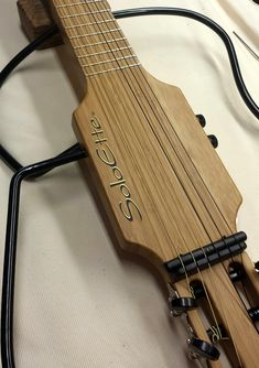 Bamboo Classic-only classical travel guitar ever made with bamboo. Very unique.