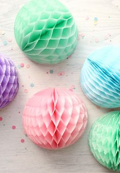 Learn how to make your own glittered honeycomb balls in this step-by-step tutorial. With a few store-bought items, you can jazz up a boring honeycomb decoration into a glittered party stopper. Tissue Paper Decorations, Tissue Paper Crafts, Diy Party Decorations, Decoration Table, Pastel Party, Honeycomb Paper, Pretty Pastel, Soft Colors, Soft Pastels