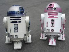The droid was originally built by members of the R2 Builders' Club for Katie Johnson, the daughter of Albin Johnson, who founded The 501st Legion. The droid was created to keep Katie company after she was diagnosed with an inoperable brain tumor in 2004. Katie died in 2005.