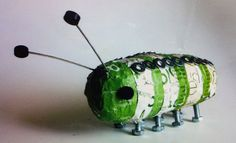 paper mache bug decorated with bolts!