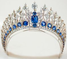 Tiara Mania: Sapphire Parure TiaraIt was ordered in 1881 from Vita Israel.  It was possibly based on an Oscar Massin design from 1867.  The diamonds are set en tremblant and the central sapphire can be removed to wear as a brooch.  In 1928, the frame was altered and some of the diamonds were removed by Van Kempen en Vos.  In 2013, and new frame was added and the central element was lowered by Steltman Jewellers.  Materials:  Ceylon sapphires and diamonds set in gold and silver