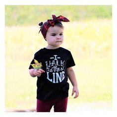 This cute girl looks determined to make Wednesday awesome as she wears her •I WALK THE LINE• tee  • • #cutekidsclub #igfashion #kidzootd #instagram_kids #trendykiddies #babiesofinstagram #kidzfashion #kidslookbook #kids_stylezz #thechildrenoftheworld #igkiddies #itsthemostwonderfultimeforwine #christmas #parenthood #mommy #mommylife #mom #momlife #gangstawrapper #gangsta #xmas #nutcracker #elfquotes #elf #sonofanutcracker #holidays